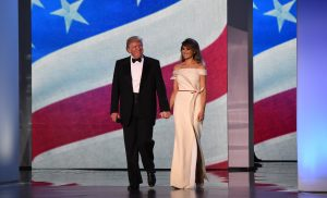 US President Donald Trump and First Lady Melania Trump take the stage at the Freedom Inaugural Ball, January 20, 2017, in Washington, DC. (ROBYN BECK/AFP/Getty Images)